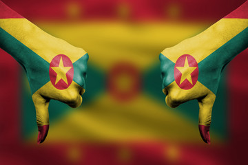 failure of Grenada - hands gesturing thumbs down in front of fla
