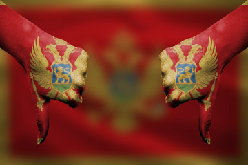 failure of Montenegro - hands gesturing thumbs down in front of