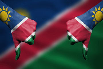 failure of Namibia - hands gesturing thumbs down in front of fla