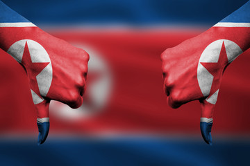 failure of  North Korea - hands gesturing thumbs down in front o