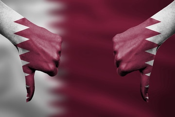 failure of Qatar - hands gesturing thumbs down in front of flag