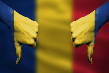 failure of Romania - hands gesturing thumbs down in front of fla