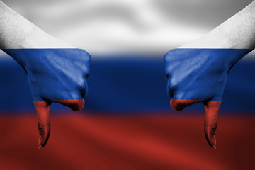 failure of Russia - hands gesturing thumbs down in front of flag