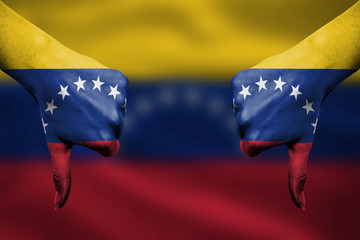 failure of Venezuela - hands gesturing thumbs down in front of f