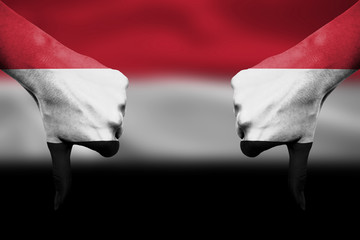 failure of Yemen - hands gesturing thumbs down in front of flag
