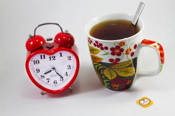 alarm clock and tea in a mug