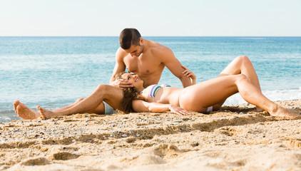 loving couple  on sand beach