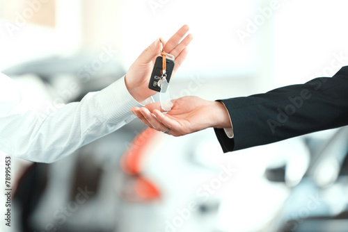 Handsome young man in dealership - 78995453