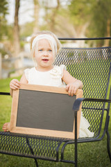 Cute Baby Girl in Chair Holding Blank Blackboard