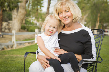 Grandmother and Granddaughter Playing At The Park