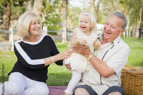 Affectionate Granddaughter and Grandparents Playing At The Park - 78997815