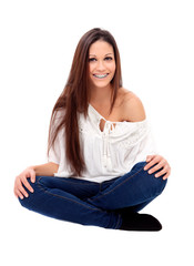 Casual young girl with brackets sitting on the floor