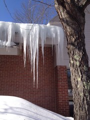 long icicles hanging from the roof