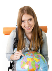 young tourist girl with world globe choosing travel destination