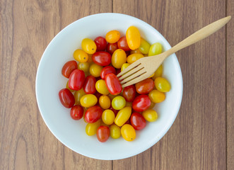 red and yellow tomatoes with a fork