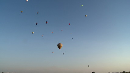 Lots of colorful hot air balloons rise into sky