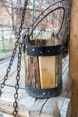 Detail of old draw well with wooden bucket