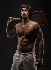 Male tennis player with racket.