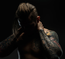 Portrait of a man with tattoos.