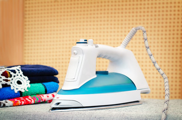 Electric iron on the Ironing Board.