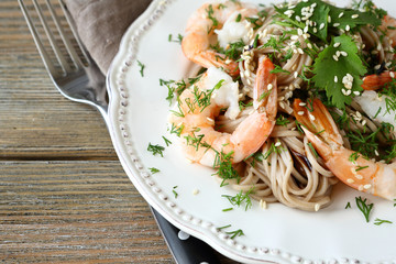 Tasty buckwheat noodles with shrimp on a plate