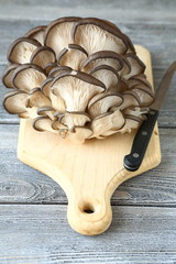 Raw mushrooms on a cutting board