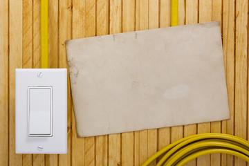 External light switch wooden wall