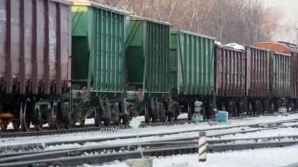 cargo train move on snow rail road in winter russia