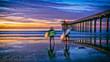 Leinwanddruck Bild - beach sunset with surfers and pier, La Jolla, San Diego, CA