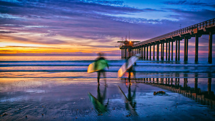 beach sunset with surfers and pier, La Jolla, San Diego, CA