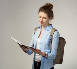 Pretty girl holding a notebook