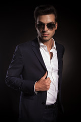 elegant business man posing on black studio background