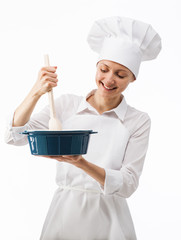 Chef cook mixing something in a bowl