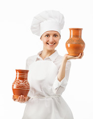 Attractive young woman holding clay jugs
