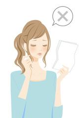 用紙を確認する女性 バツ