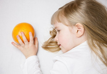 Adorable little girl with ripe grapefruit