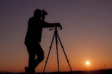 Man with old camera and tripod