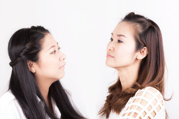 Two aggressive womenisolated on a white background
