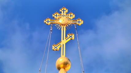 Religious cross with loopable sky background