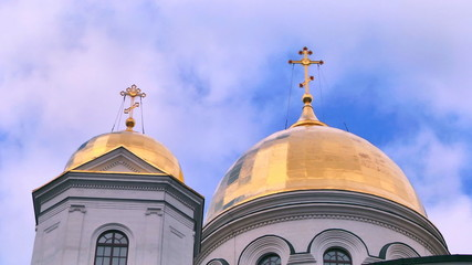 church with crosses on domes