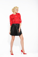Elegant Blonde in Black Frilly Skirt and Red Blouse
