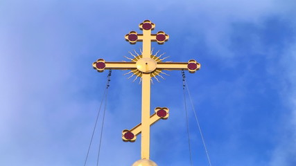 cross on the dome of the church
