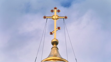 cross on the dome of the church against the sky