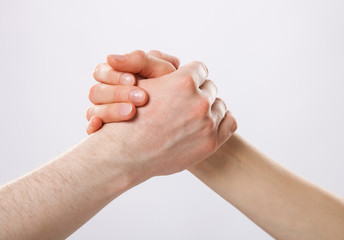 Handshake on grey background