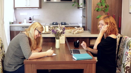 Happy women working at home office