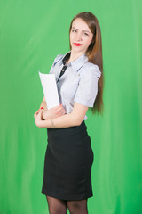 young woman model in office dress on green chromakey background