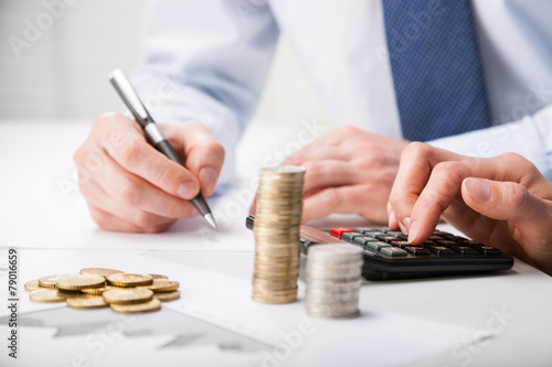 Accountants calculating profit - 79016659