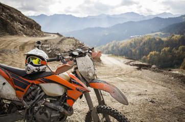 Dirty enduro motorcycle motocross helmet on road