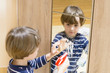 Boy Cleaning the Mirror