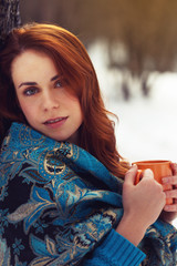 Beautiful woman holding tea cup